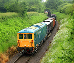 Electro-Diesel 73119 kicked off the 2012 Mixed Traffic Weekend proceedings on 16 June with a demonstration goods that left Minehead at 08:00 for Bishops Lydeard.  It was captured at a very d ...